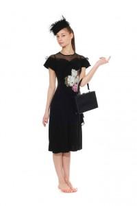 schwarzes 30er Jahre Kleid mit Bumenapplikationen Gr. 34