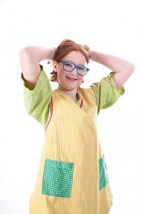 grünes Kleid und gelbe Schürze